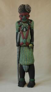 Bamileke/Kamerun -  Postać dostojnika, drewno pokryte koralikami szklanymi, muszelki kauri,  wys. 151 cm